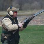 man shooting trap targets